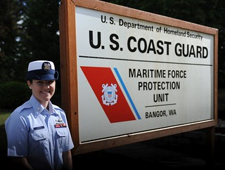 Coast Guard Petty Officer 3rd Class Whitney Jackson , a maritime enforcement specialist assigned to Coast Guard Maritime Force Protection Unit Bangor in Silverdale, Wash., poses for a photo in front of the MFPU Bangor office, July 25, 2014. Jackson attended the Julius A. Kolb Airman Leadership School at Joint Base Lewis-McChord, Wash., and was nominated by her peers and instructors to receive the Commandant's Award for her leadership ability while at school. (U.S. Coast Guard photo by Petty Officer 3rd Class Katelyn Shearer)