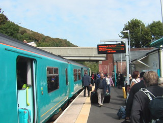 Class 150 train at Fishguard & Goodwick station, with passengers leaving
