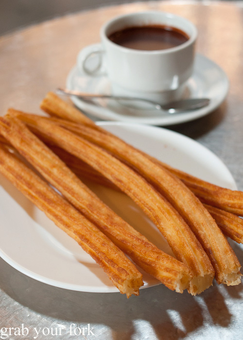 Chocolate con churros at Chocolateria San Gines in Madrid, Spain