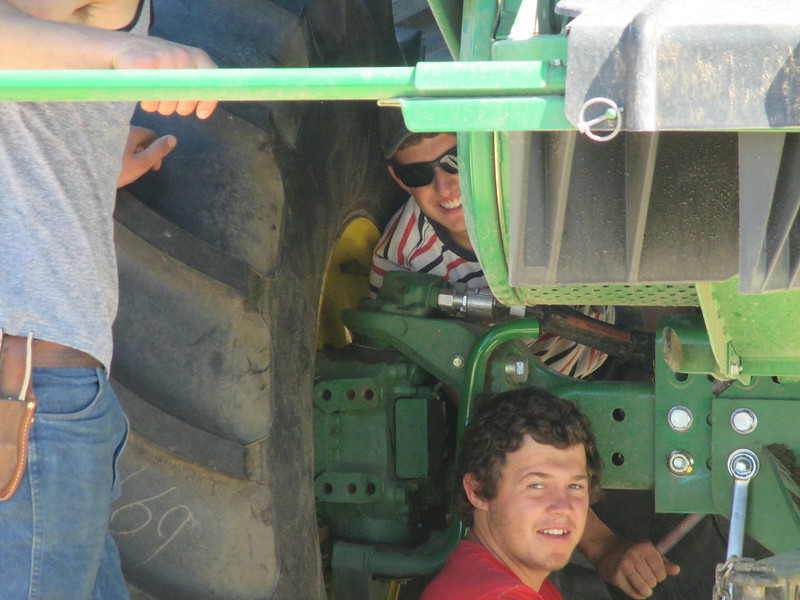 Ed and Theo put hitches on the combines to pull headers
