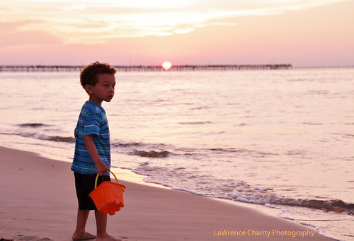 ocean boy sunset portrait white black beach canon eos virginia bucket mixed model child view blueeyes va 7d biracial curlyhair fishingpier 18200mm canoneos7d lawrencecharityphotography