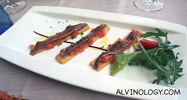 Anchovies from the cantabrian sea over a parmesan homemade tart with tomato tartar