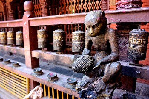 a monkey statue with his durian at the Golden Temple in Patan