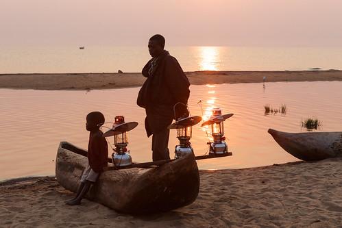 people water sunrise boat malawi lakemalawi dugoutcanoe centralregion kumkama