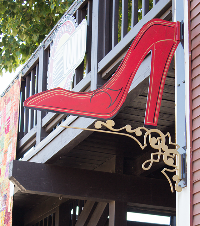 red stiletto heel store sign