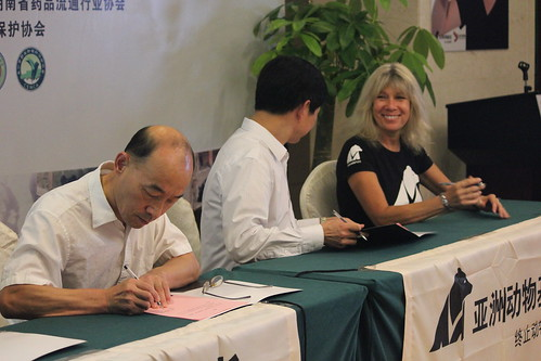 Animals Asia founder and CEO Jill Robinson MBE signing contracts with major pharmacy chain owners