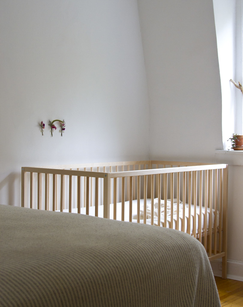 a crib in a tiny apartment   reading my tea leaves