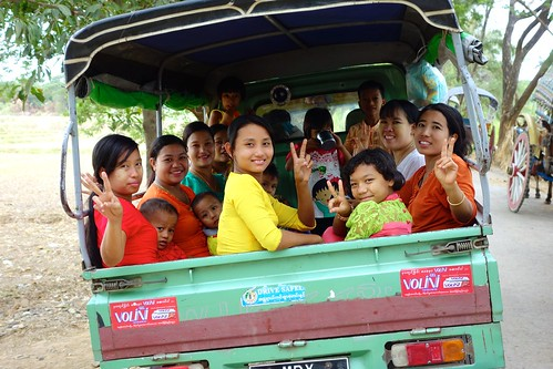 Burmese locals in back of truck, Myanmar