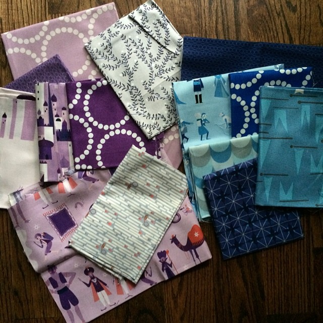 I wonder if my #schnitzelandboominiquiltswap partner would prefer a blue or purple mini quilt. Hmmm. What do you think? #makeaquiltmakeafriend