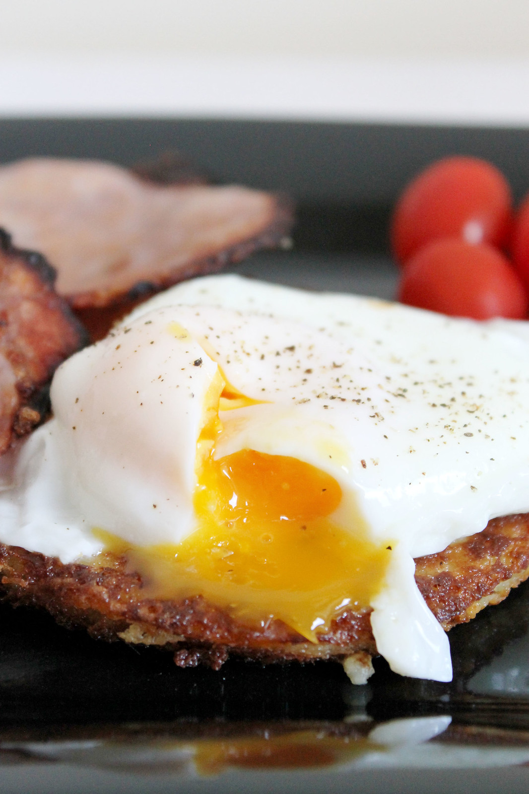 potato pancakes with poached eggs and bacon