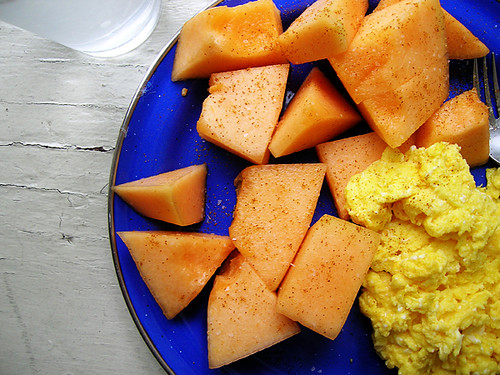 scrambled eggs and cantaloupe