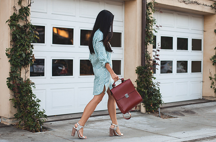 Stephanie Liu of Honey & Silk wearing Plum Pretty Sugar Anouk Boyfriend Shirt, Kelsi Dagger Backpack, and Coach Lexey Heels