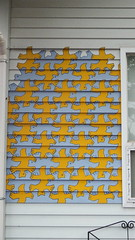 textile(0.0), window(0.0), curtain(0.0), glass(0.0), window valance(0.0), lighting(0.0), modern art(0.0), art(1.0), yellow(1.0), mural(1.0), interior design(1.0),