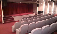movie theater(0.0), function hall(0.0), room(0.0), theatre(1.0), auditorium(1.0), interior design(1.0), conference hall(1.0), convention center(1.0),