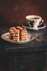 Honey cake on old wooden table.