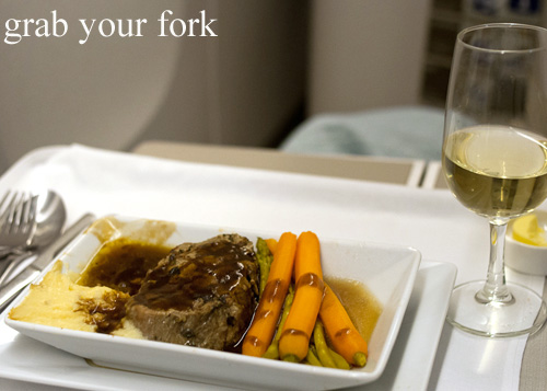 Steak with mushroom sauce, mashed potato and vegetables on British Airways business class Singapore to Sydney