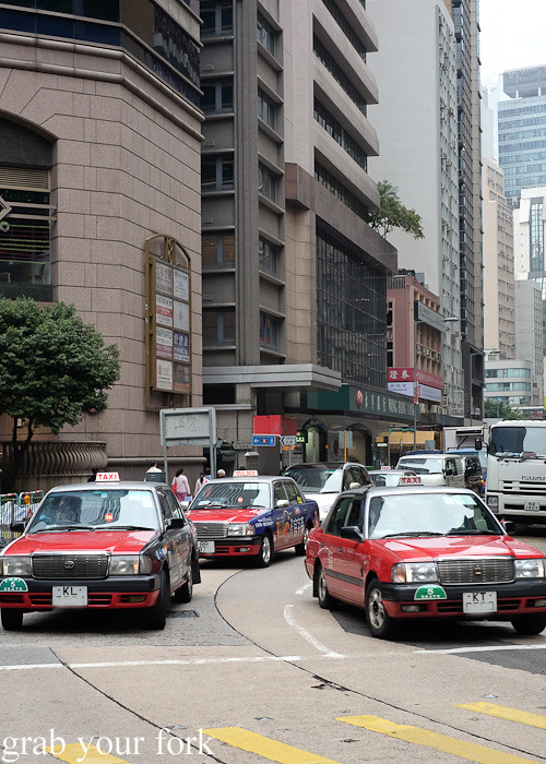 Hong Kong taxi cabs on Des Voeux Road, Central district, Hong Kong
