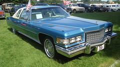cadillac fleetwood(0.0), automobile(1.0), automotive exterior(1.0), cadillac(1.0), vehicle(1.0), cadillac fleetwood brougham(1.0), cadillac brougham(1.0), cadillac calais(1.0), full-size car(1.0), cadillac coupe de ville(1.0), sedan(1.0), land vehicle(1.0), luxury vehicle(1.0),
