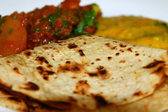 Potato and chicken curry, lentils and chapati
