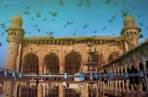 india reflection water birds architecture sunrise reflections earlymorning streetphotography mosque friday hyderabad inverted goldenhour charminar lightroom nizam namaz andhrapradesh meccamasjid telangana heritagewalks canon550d
