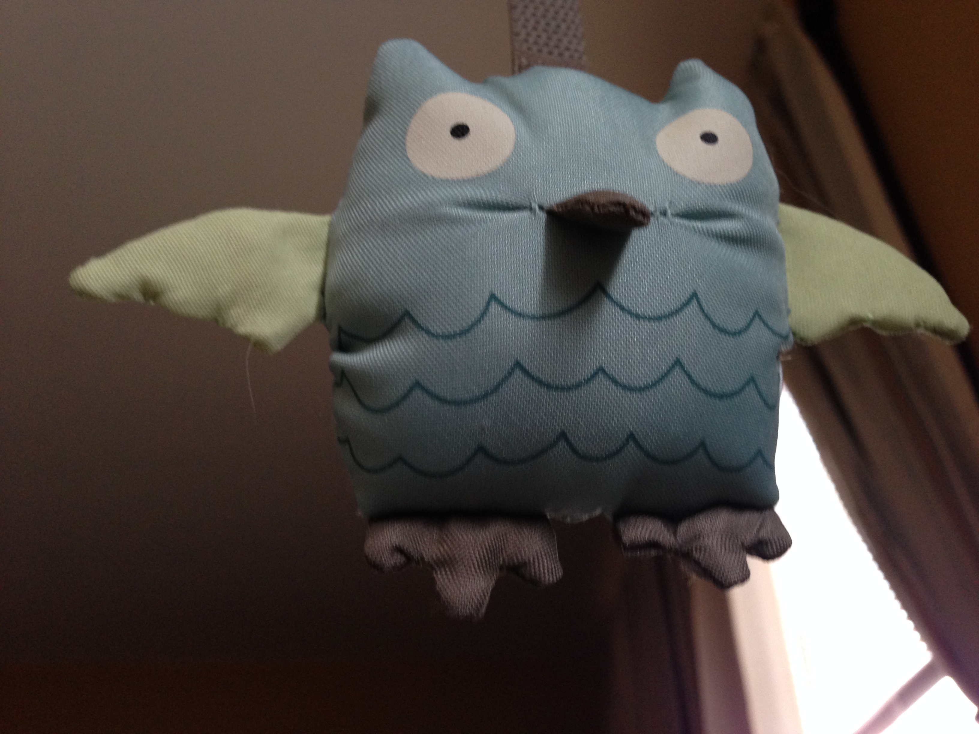 Stuffed Owl on the Crib
