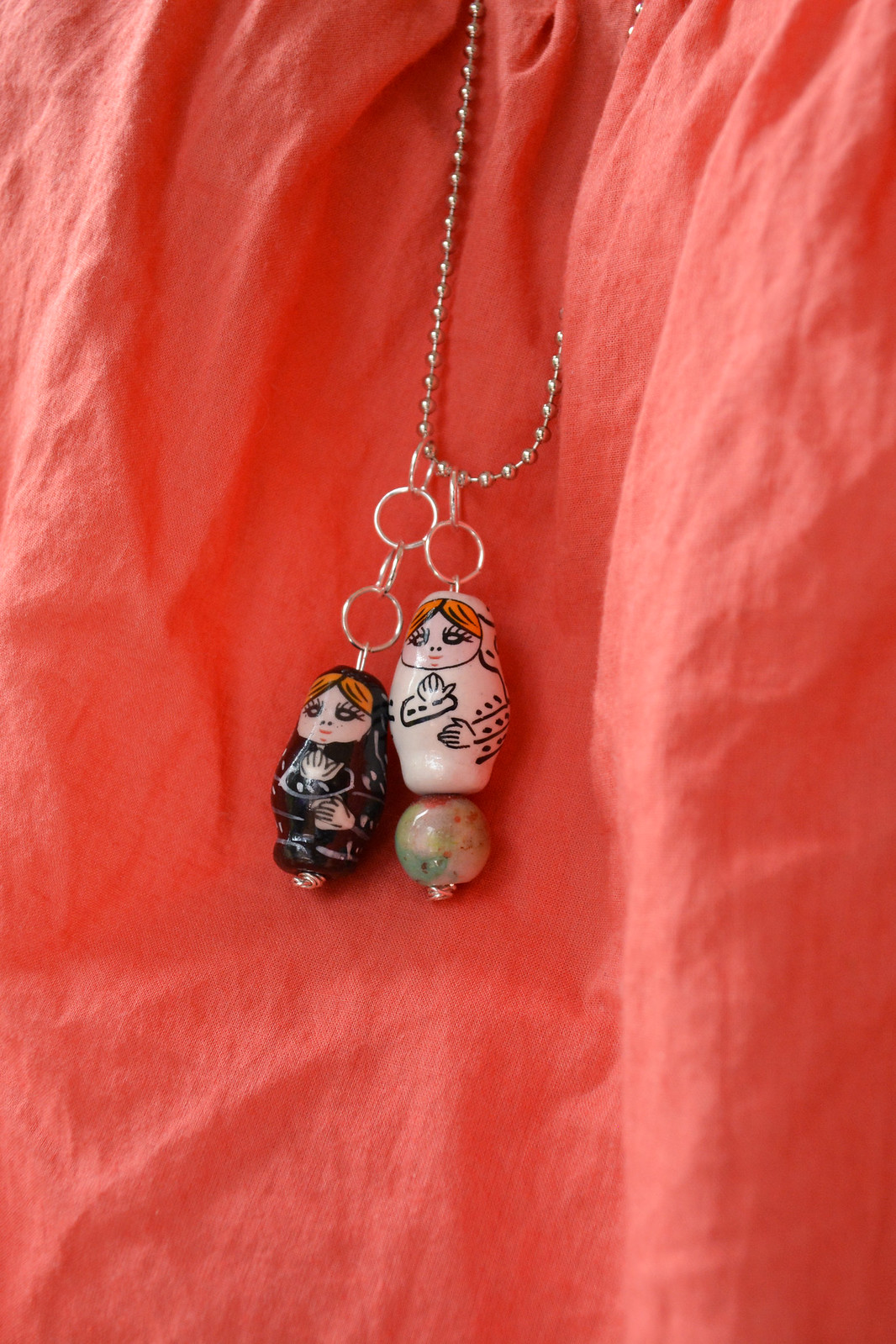 Make a cute, quirky matryoshka doll necklace in just a few simple steps