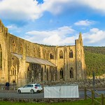 Tintern Abbey (Welsh: Abaty Tyndyrn) was founded by Walter de Clare, Lord of Chepstow, on 9 May 1131. It is situated in the village of Tintern in Monmouthshire, on the Welsh bank of the River Wye, Wales.