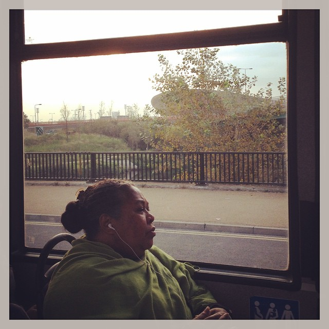A very elegant woman in a magnificent green pashmina, with the velodrome in the background. #onthebus #london #joysofcommuting