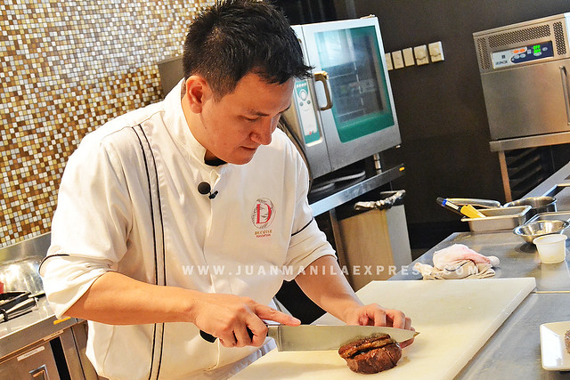 CHEF MARTIN PUNZALAN. Chef carefully slices the beef tenderloin for the Rossini flavored with truffle in Risotto and Foie Gras.