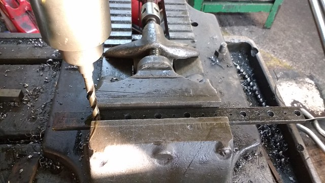 Drilling the handle mounting pads