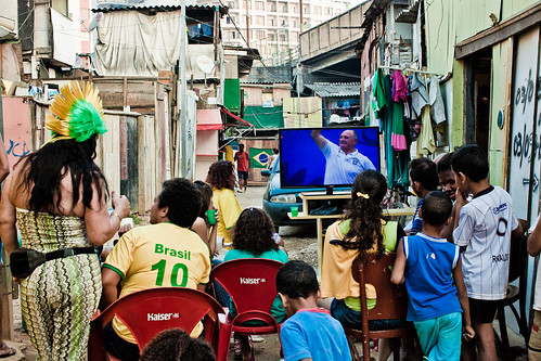 People watching World Cup on the TV, on the street in Brazil