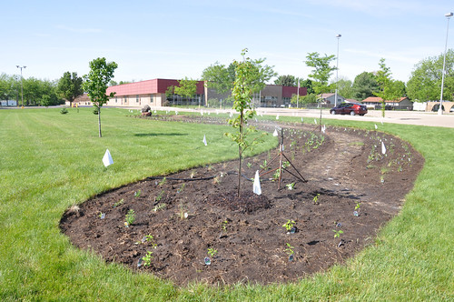 The pollinator garden plants were finally in and sprinklers began watering. NRCS photo.