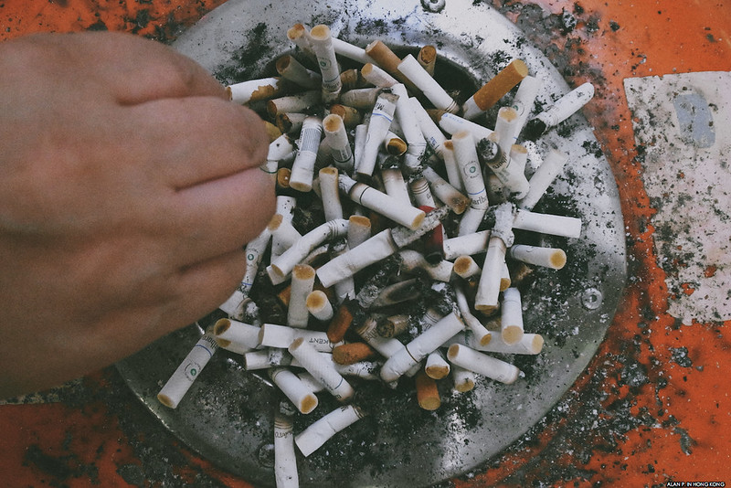 Cigarette butt tray
