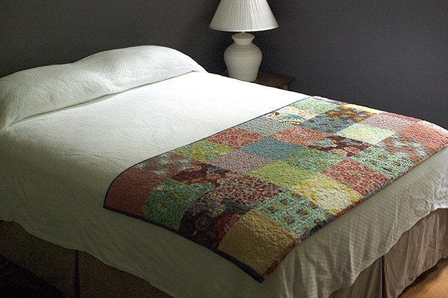 Patchwork Quilt Folded at Foot of Bed