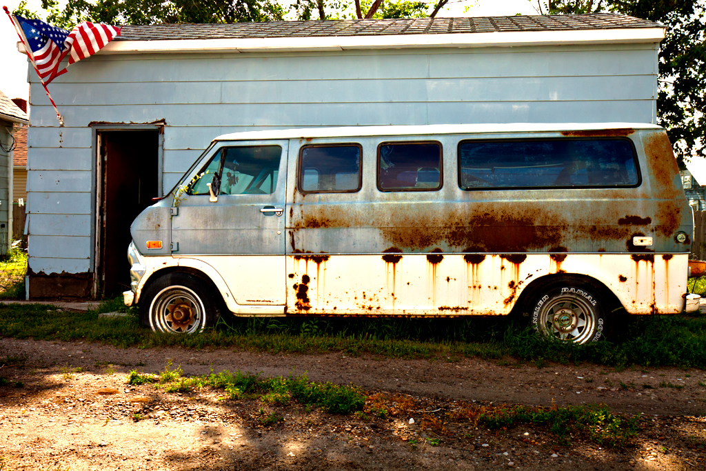 Rusty-van-and-flag--Williston