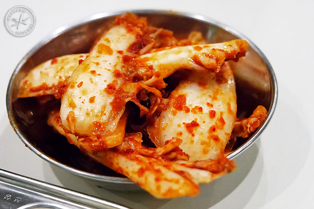 Gutjeri - Fresh napa cabbage is marinated in a chilli based sauce, and served fresh, like an unfermented kimchi.