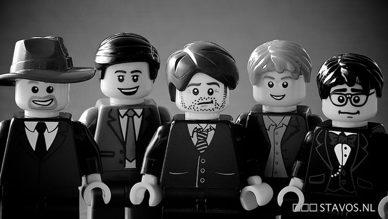 An image of lego figures dressed in different suits.
