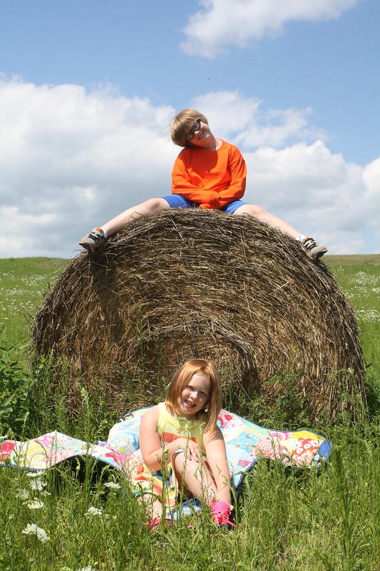 who doesn't love climbing atop at hay roll and posing?