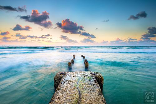 ocean sunset water clouds israel pier telaviv rocks jetty