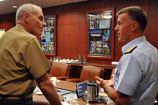 Coast Guard Commandant, Adm. Paul Zukunft (right), and U.S. Southern Command Commander, Gen. John Kelly meet at U.S. Southern Command Headquarters Sept. 4, 2014, to discuss strategic objectives, mutual priorities and opportunities for collaboration in Latin America and the Caribbean. The meeting centered on the synchronization of existing efforts in ensuring safety and security along U.S. and regional borders in addition to outlining new initiatives, including the U.S. Coast Guard Western Hemisphere strategy to be released in late September. (U.S. Coast Guard photo by Petty Officer 2nd Class Patrick Kelley)