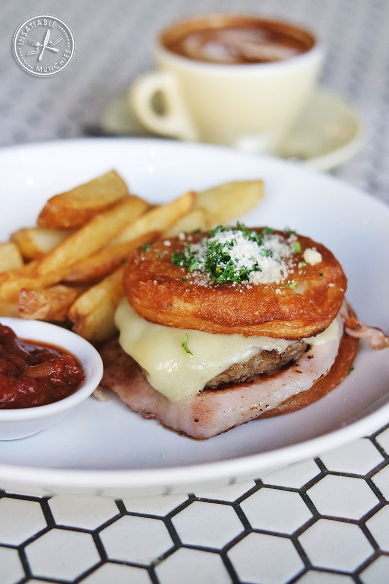 Elvis burger - Savoury 'brewnut' (cronut) with beef patty, Canadian bacon and cheese. Served with a side of chips and tomato chutney.