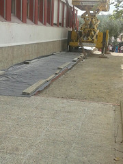 floor(0.0), asphalt(0.0), outdoor structure(0.0), sidewalk(0.0), driveway(0.0), road surface(0.0), walkway(0.0), flooring(0.0), brickwork(0.0), tarmac(0.0), wall(1.0), concrete(1.0),