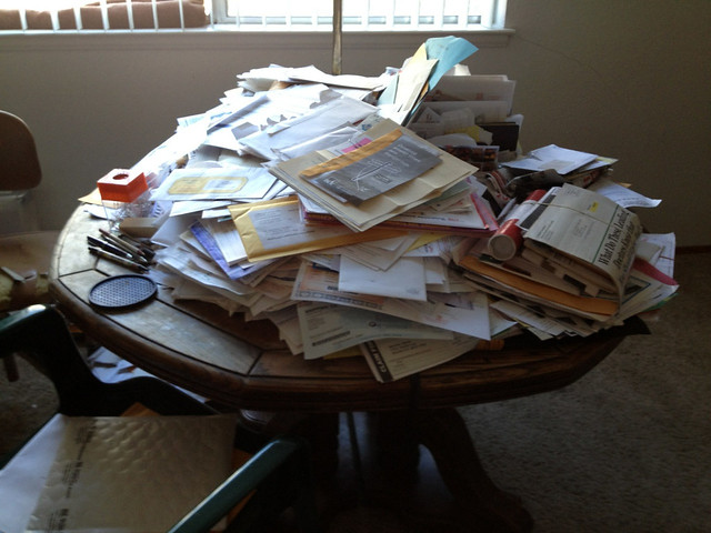 Table with a mound of junk mail