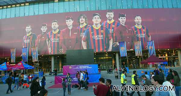 Giant poster of Qatar stewardess with FCB players