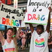 """Inequality is a Drag"" - an important reminder from Oxfam partner, Mojalifa Mokoele, and Oxfam Canada Outreach team member, Erin Aylward, at the World Pride Trans March."