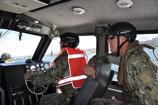 U.S. Coast Guard Chief Petty Officer Tony Tredo, Charlie Company Platoon Leader, 1st Platoon, U.S. Navy Coastal Riverine Squadron (CORIVRON) 11 observes U.S. Navy Petty Officer 1st Class Jeremiah Rees, conduct small boat training during Rim of the Pacific (RIMPAC) Exercise 2014. Twenty-two nations, more than 40 ships and six submarines, about 200 aircraft and 25,000 personnel are participating in RIMPAC from June 26 to August 1, in and around the Hawaiian Islands and Southern California. The world's largest international maritime exercise, RIMPAC provides a unique training opportunity that helps participants foster and sustain the cooperative relationships that are critical to ensuring the safety of sea lanes and security on the world's oceans. RIMPAC 2014 is the 24th exercise in the series that began in 1971. (U.S. Coast Guard photo by Lt. Cmdr. Steven Youde/Released)