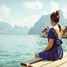 Girl in blue dress sitting by Cheow Lan Lake by SamKent22