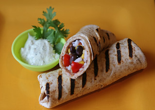 Picture of grilled rice and black bean burrito with creamy cilantro dipping sauce