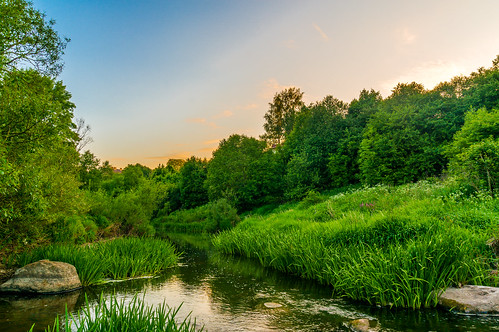 blue trees sunset summer sky green water grass stone river stones lithuania kretinga akmena