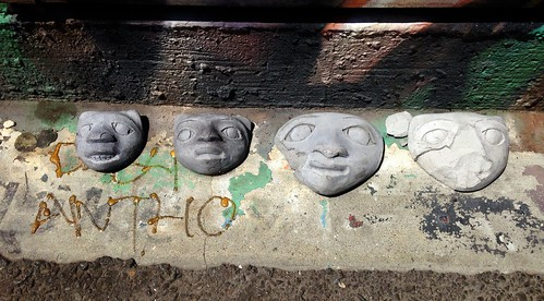 Bini faces in Clarion Alley